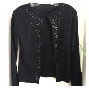 Sweaters - Cardigan with small diamond like detail.
